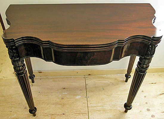 Repaired antique card table