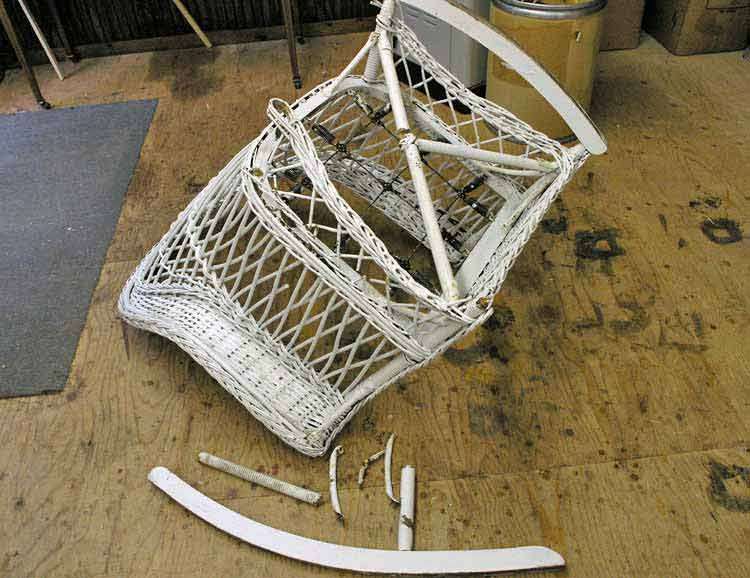 Broken wicker rocker turned over