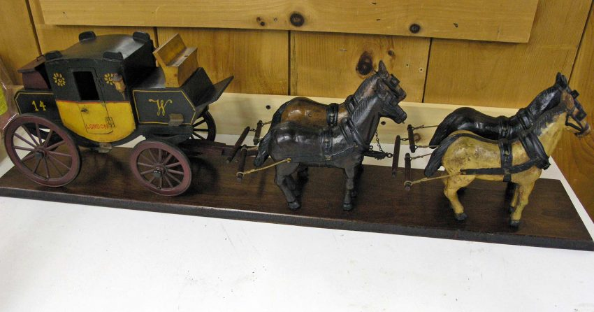 Miniature stagecoach replica after repair