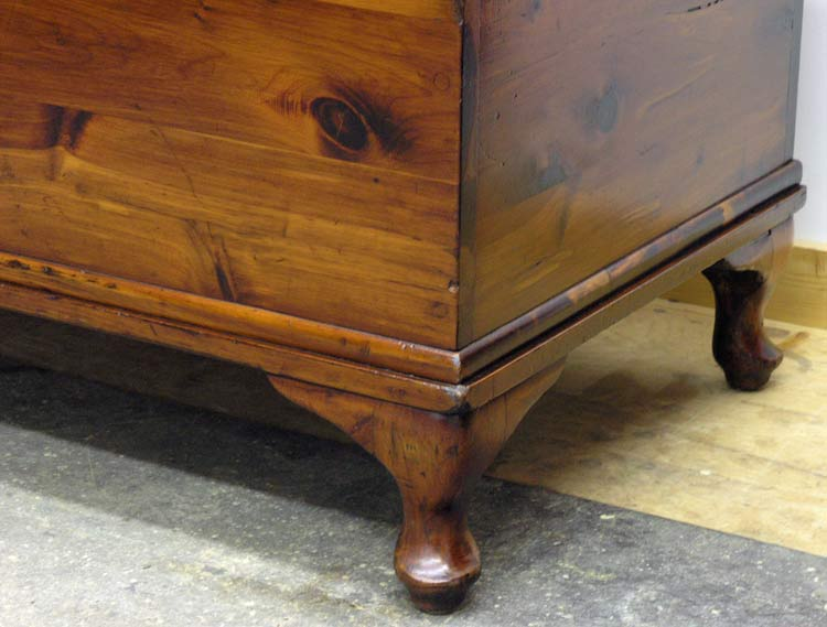 Cabriole feet on cedar chest after restoration