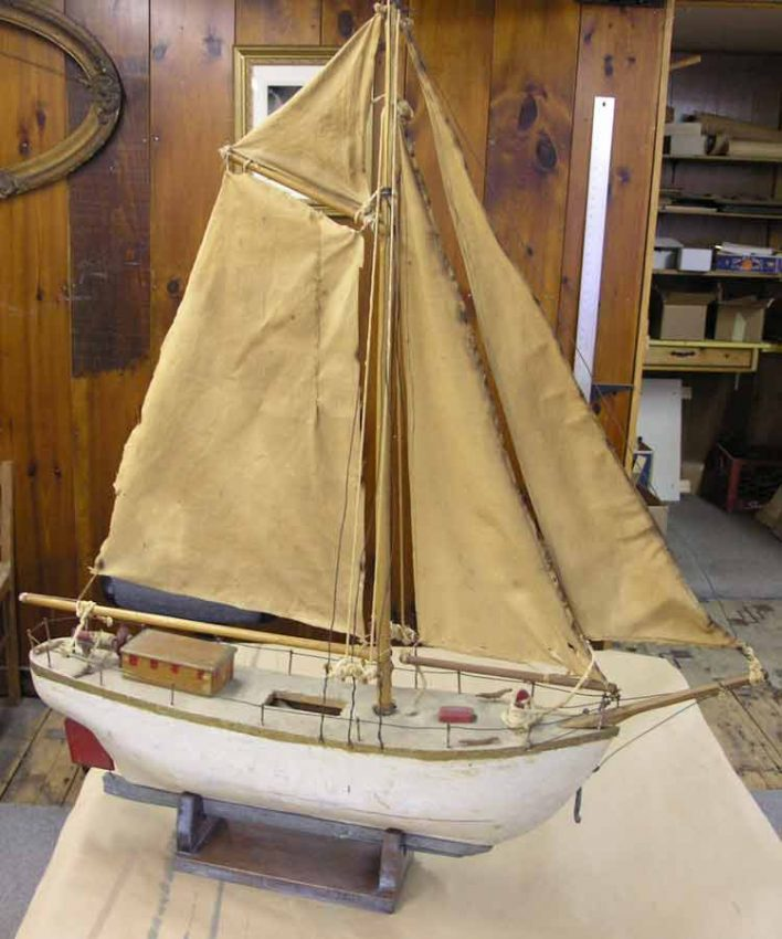 Wooden model sailboat after restoration