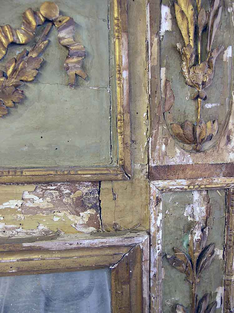 Gesso and gilding flaking off trumeau mirror