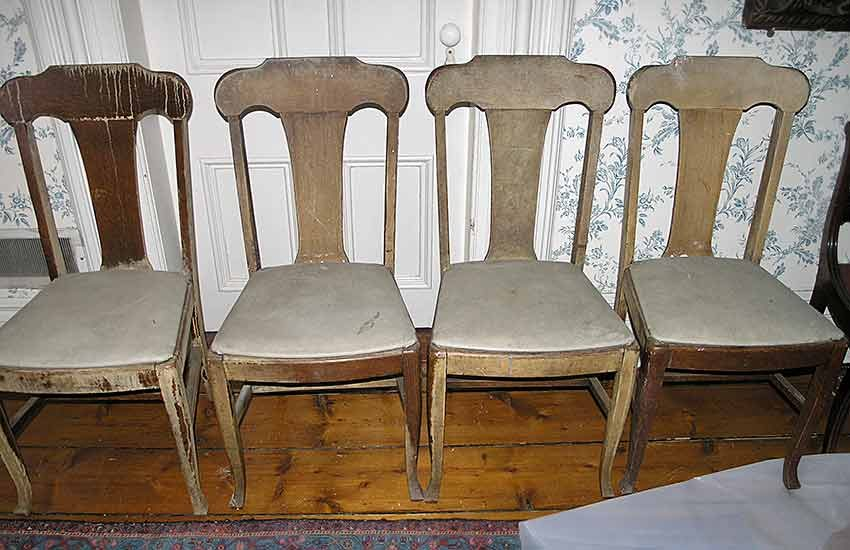 4 Oak chairs before refinishing
