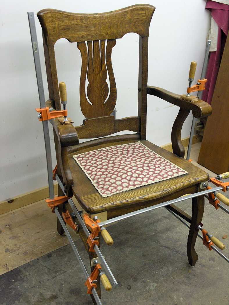 Oak chair glued and clamped