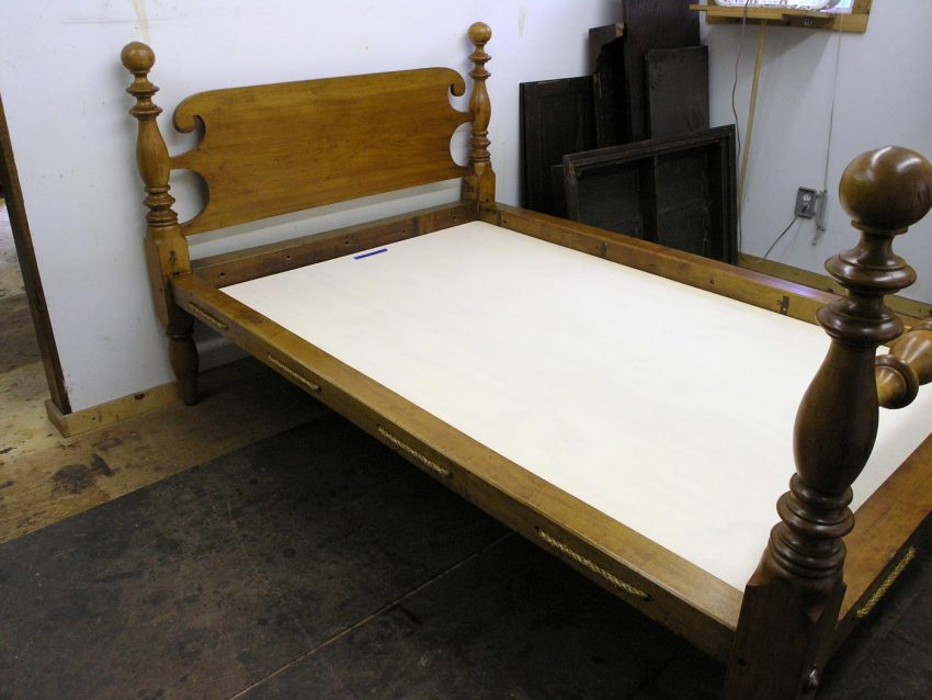 Antique cannonball bed with rope on rails