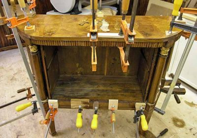 Repairing furniture with glue and clamps